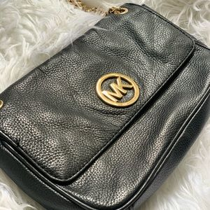 Michael Kors Bags - Michael Kors black clutch with gold hardware
